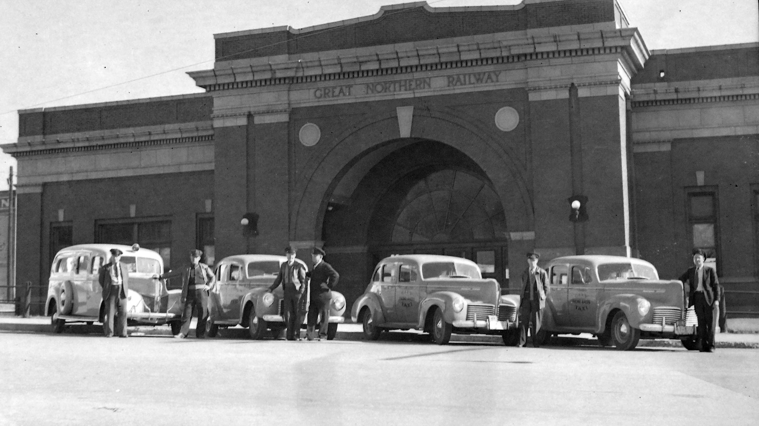 Taxis lined up in front of the Great Northern Depot